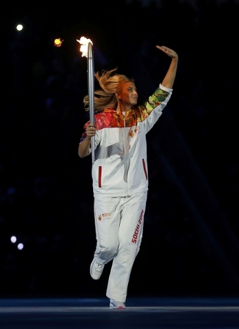 Tennis player Maria Sharapova carries the Olympic flame during the opening ceremony of the 2014 Sochi Winter Olympics, February 7, 2014.  REUTERS/Jim Young (RUSSIA  - Tags: OLYMPICS SPORT)