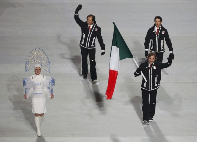 Mexico's flag-bearer Hubertus Von Hohenlohe leads his country's contingent  during the opening ceremony of the 2014 Sochi Winter Olympics, February 7, 2014.                                     REU ...
