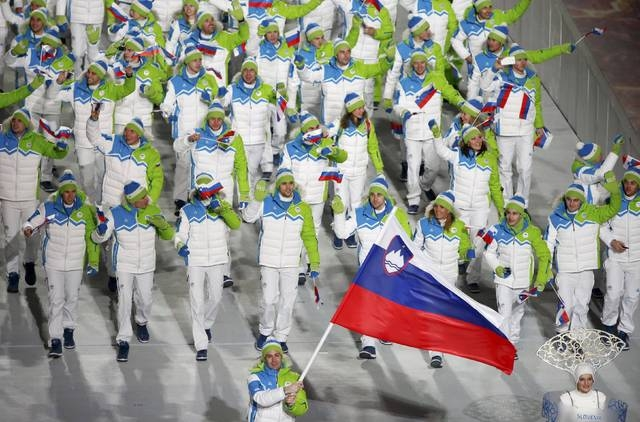 Slovenia's flag-bearer Tomaz Razingar leads his country's contingent during the athletes' parade at the opening ceremony of the 2014 Sochi Winter Olympics, February 7, 2014.      REUTERS/Lucy Nich ...