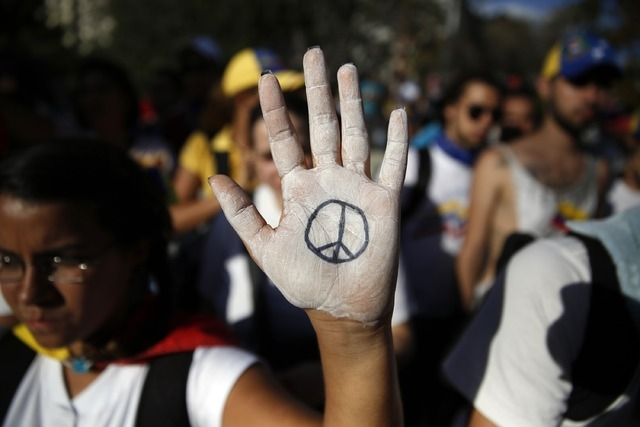 Opposition demonstrators take part in a protest against President Nicolas Maduro's government in Caracas February 16, 2014. A Venezuelan opposition leader wanted by police in connection with deadl ...