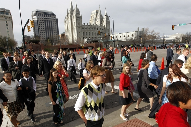 This April 6, 2013, file photo, shows the Salt Lake Temple as people walk to the Conference Center before the start of the 183rd Annual General Conference of The Church of Jesus Christ of Latter-d ...