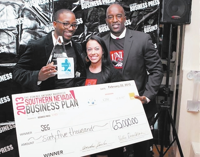 Sports Entertainment Gear founders, from left, Brian Harge, Meghan McGaugh and Travis Williams pose with their check Friday after winning the 2013 Dominic Anthony Marrocco Southern Nevada Business ...