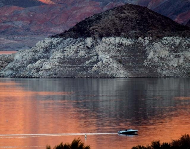 A boat cruises near the shoreline at Boulder Beach on Lake Mead in December 2011. The water level at the lake is down by about 100 feet now, Lake Mead National Recreation Area spokeswoman Christie ...