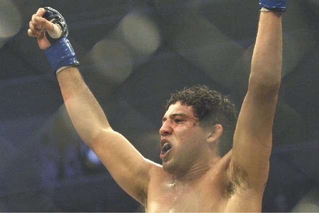 Gilbert Melendez, shown on Dec. 19, 2009, after winning a Strikeforce lightweight title bout, will remain in the Ultimate Fighting Championship and challenge Anthony Pettis for the lightweight bel ...