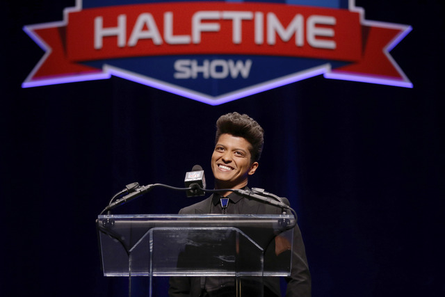 Bruno Mars who will headline the half-time show at the NFL Super Bowl XLVIII football game speaks during a press conference Thursday, Jan. 30, 2014, in New York. (AP Photo)