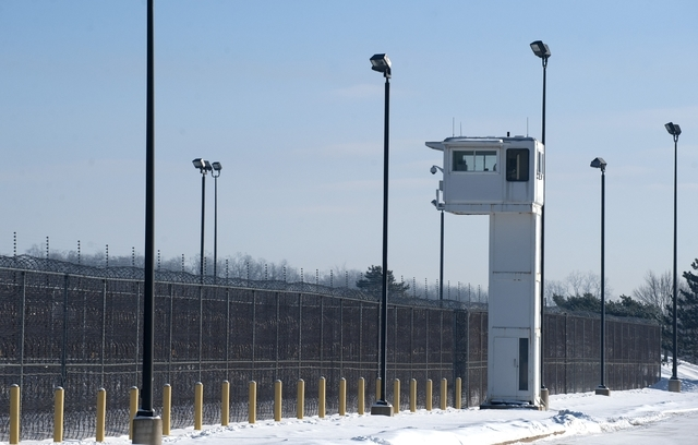 A guard tower stands over fencing at the Ionia Correctional Facility Monday, Feb. 3, 2014.  A national manhunt is underway for convicted killer Michael Elliot  who escaped from the prison on Sunda ...