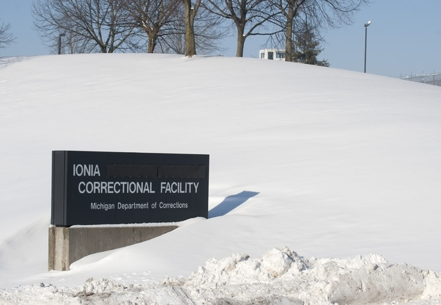 Snow blankets the Ionia Correctional Facility in Michigan Monday Feb. 3, 2014. A national manhunt is underway for convicted murderer  Michael Elliot  who escaped Sunday from the prison.    (AP Pho ...