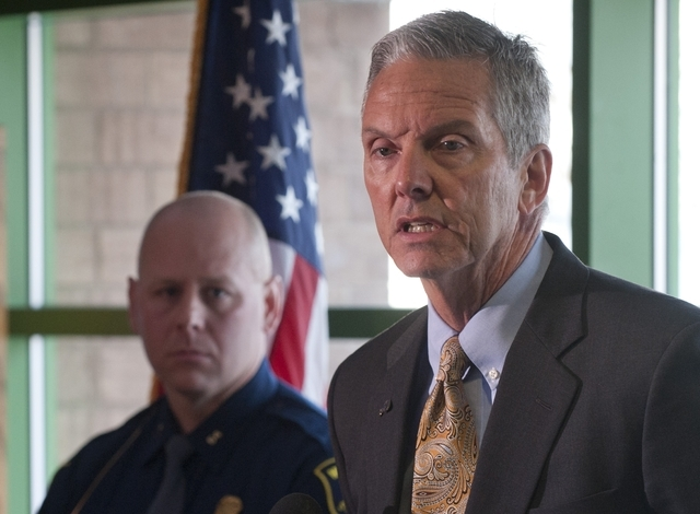 Dan Heyns, director of Michigan Department of Corrections, talks about Michael David Elliot's Sunday escape from the Ionia Correctional Facility Monday, Feb. 3, 2014.  (AP Photo/The Grand Rapids P ...