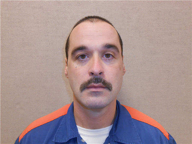Michael David Elliot, who is serving life behind bars for murder in four 1993 deaths, escaped Sunday from a Michigan prison and was apprehended Monday night, according to officials. Michigan Depar ...