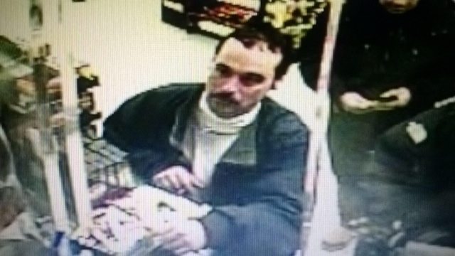 An imaage from a video surveillance camera release by the Michigan State Police shows Ionia Correctional Facility escapee Michael David Elliot, 40,   at an Indiana Marathon gas station late Sunday ...