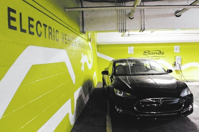 A Tesla Model S refuels at a charging station in the parking structure at The Venetian.