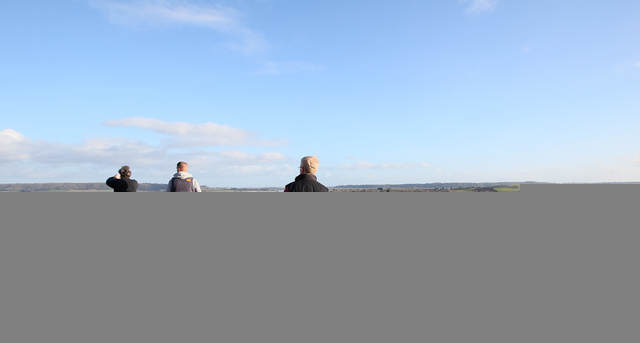 In this photo taken Sunday Feb. 2, 2014, people take photos and look at the flooding from the River Parrett on the Somerset Levels from Barrow Mump, Somerset, England, Here on the Somerset Levels  ...