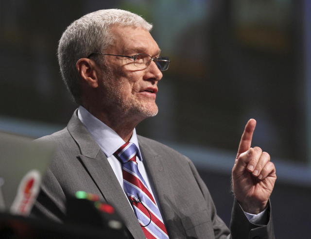 """Creation Museum head Ken Ham speaks during a debate on evolution with TV's """"Science Guy"""" Bill Nye, not shown, at the Creation Museum Tuesday, Feb. 4, 2014, in Petersburg, Ky. Ham believe ..."""