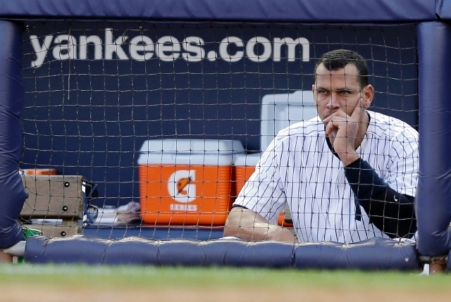 In this Oct. 14, 2012 file photo, New York Yankees' Alex Rodriguez sits in the dugout after striking out in the second inning of Game 2 of the American League championship series against the Detr ...