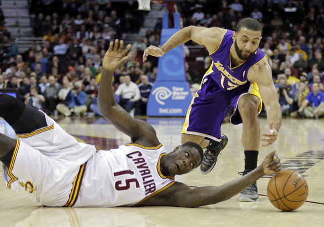 Cleveland Cavaliers' Anthony Bennett (15) bats a loose ball away from Los Angeles Lakers' Kendall Marshall in the fourth quarter of an NBA basketball game on Wednesday, Feb. 5, 2014, in Cleveland. ...