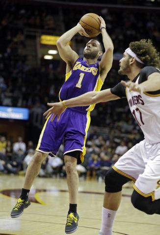 Los Angeles Lakers' Jordan Farmar (1) shoots against the Memphis Grizzlies Cleveland Cavaliers' Anderson Varejao, from Brazil, in the second quarter of an NBA basketball game on Wednesday, Feb. 5, ...