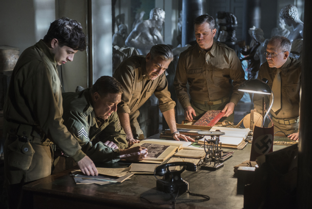 "This image released by Columbia Pictures shows Dimitri Leonidas, John Goodman, George Clooney, Matt Damon and Bob Balaban in ""The Monuments Men."" (AP Photo/Columbia Pictures, Claudette B ..."