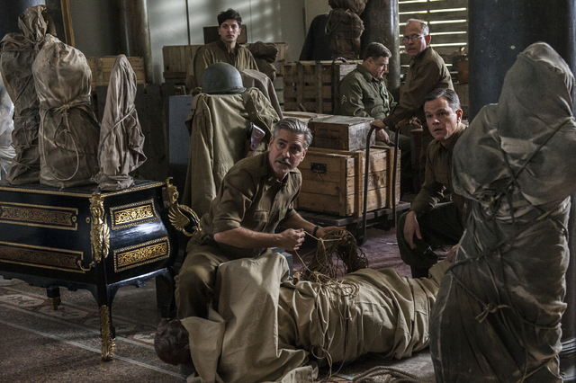 "This image released by Columbia Pictures shows, from left, Dimitri Leonidas, George Clooney, John Goodman, Bob Balaban and Matt Damon in the film, ""The Monuments Men."" The World War II d ..."