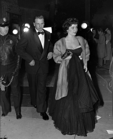 In this Dec. 21, 1949 file photo, Elizabeth Taylor arrives for a Hollywood movie premier with Pittsburgh Pirates' Ralph Kiner, in Los Angeles. The baseball Hall of Fame says slugger Ralph Kiner ha ...