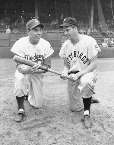 In this July 23, 1951 file photo, Gil Hodges, left, and Ralph Kiner pose. The baseball Hall of Fame says slugger Ralph Kiner has died. He was 91. The Hall says Kiner died Thursday, Feb. 6, 2014, a ...