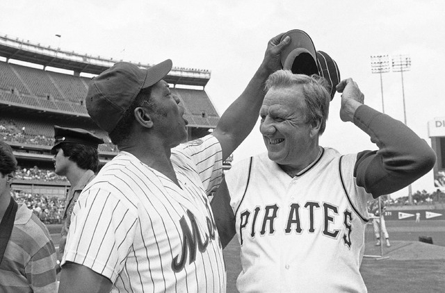In this Aug. 14, 1982 file photo, Willie Mays tries to get Ralph Kiner�hat as the two Hall of Famers pose for pictures before the start of Old Timers Day game at Shea Stadium in New York.  The b ...