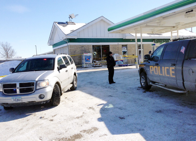 Authorities gather at a gas station in West Branch, Iowa, where a missing newborn was found alive Friday, Feb. 7, 2014. Police said they found Kayden Powell, who's nearly a week old, after they he ...