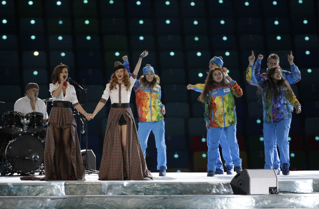 Russian duo t.A.T.u. Lena Katina, third from left, and Yulia Volkova, second from left,  perform on stage before the opening ceremony of the 2014 Winter Olympics in Sochi, Russia, Friday, Feb. 7,  ...
