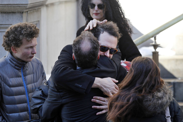 Writer David Bar Katz is embraced as he arrives at the Church of St. Ignatius Loyola for the private funeral of actor Philip Seymour Hoffman Friday, Feb. 7, 2014, in New York. Hoffman, 46, was fou ...