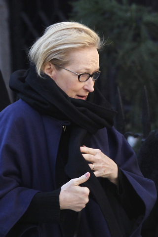 Actress Meryl Streep arrives at the Church of St. Ignatius Loyola for the private funeral of actor Philip Seymour Hoffman Friday, Feb. 7, 2014, in New York. Hoffman, 46, was found dead Sunday of a ...