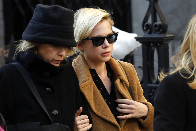 Actress Michelle Williams, right, arrives at the Church of St. Ignatius Loyola for the private funeral of actor Philip Seymour Hoffman Friday, Feb. 7, 2014, in New York. Hoffman, 46, was found dea ...