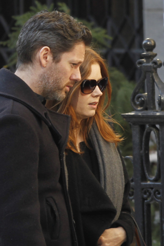 Actress Amy Adams  and her fiance Darren Le Gallo arrive at the Church of St. Ignatius Loyola for the private funeral of actor Philip Seymour Hoffman Friday, Feb. 7, 2014, in New York. Hoffman, 46 ...
