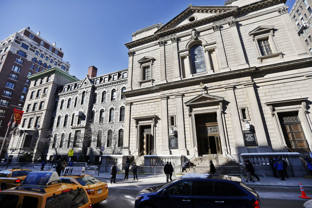 Barricades are placed outside of the Church of St. Ignatius Loyola before the funeral of actor Philip Seymour Hoffman Friday, Feb. 7, 2014, in New York. Hoffman, 46, was found dead Sunday of an ap ...