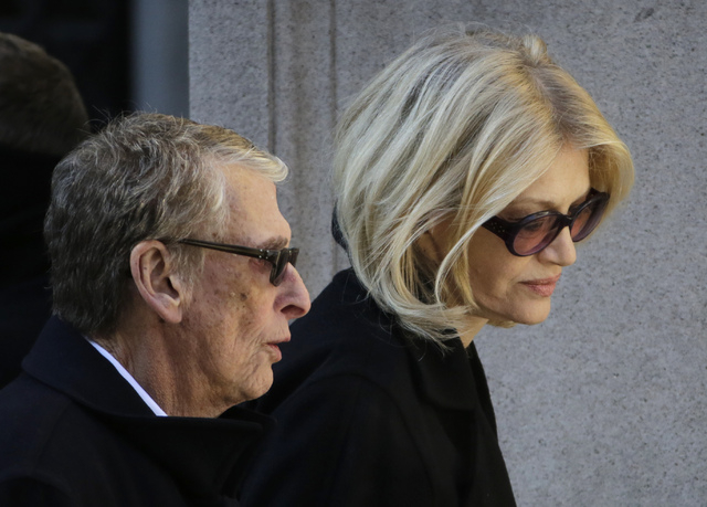 Director Mike Nichols, left, and Diane Sawyer arrive for the funeral of actor Philip Seymour Hoffman at the Church of St. Ignatius Loyola, Friday, Feb. 7, 2014 in New York. Hoffman, 46, was found  ...