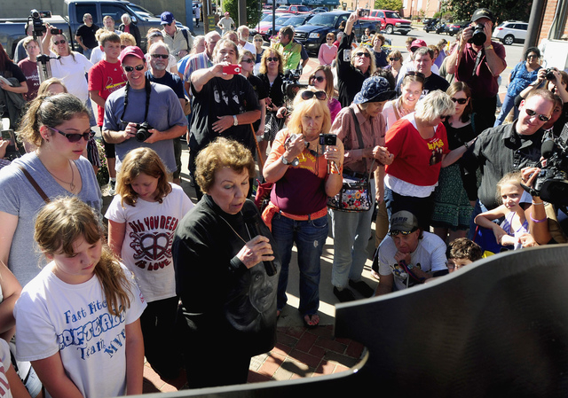 In this photo taken on Sept. 21, 2013, Louise Harrison, the sister of late Beatles guitarist George Harrison, reads off the historical marker honoring her famous brother's September 1963 visit to  ...