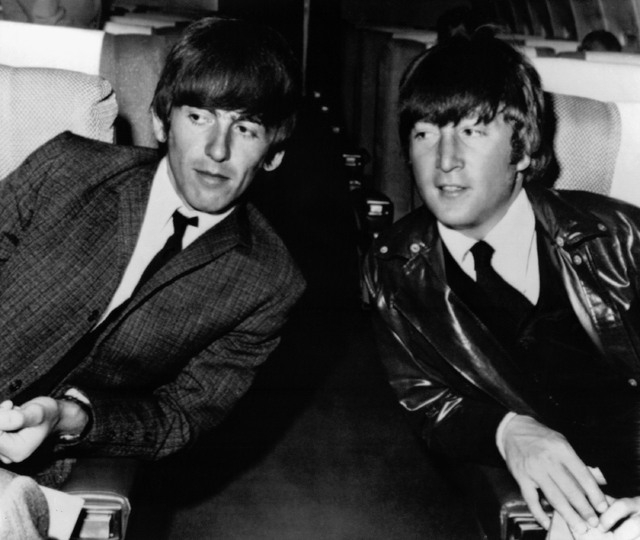 In this May 25, 1964 file photo, the Beatles' George Harrison, left, and John Lennon, are seen aboard an airplane in Los Angeles, before leaving for London. In the fall of 1963, Harrison spent two ...