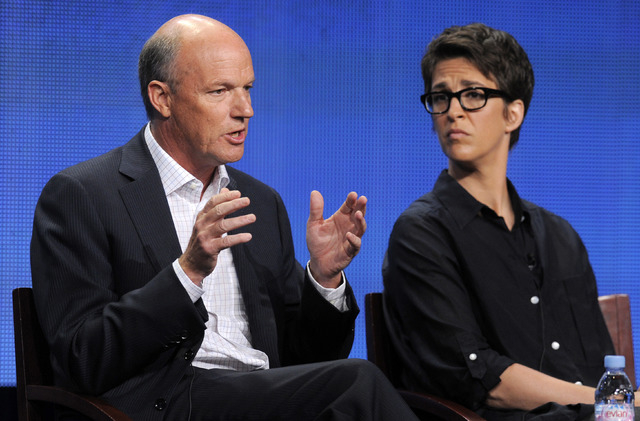"""MSNBC President Phil Griffin, left, answering a question as Rachel Maddow, host of """"The Rachel Maddow Show,"""" looks on at the NBC Universal summer press tour in Beverly Hills, Calif.  In the wake o ..."""