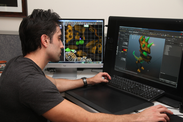 In this Tuesday, Jan. 28, 2014 photo, Sonic Boom lead character artist Daniel Ramirez Guardon works on a character from the new Sonic the Hedgehog video game at Big Red Button Entertainments offic ...