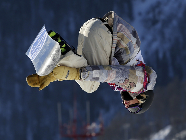 United States' Sage Kotsenburg takes a jump during the men's snowboard slopestyle semifinal at the Rosa Khutor Extreme Park, at the 2014 Winter Olympics, Saturday, Feb. 8, 2014, in Krasnaya Polyan ...