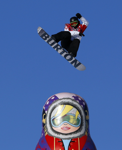 Canada's Mark McMorris takes a jump during the men's snowboard slopestyle semifinal at the Rosa Khutor Extreme Park, at the 2014 Winter Olympics, Saturday, Feb. 8, 2014, in Krasnaya Polyana, Russi ...