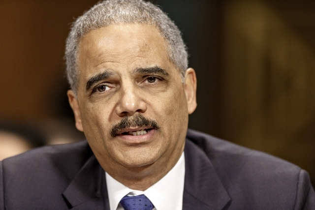 Attorney General Eric Holder testifies on Capitol Hill in Washington. In an assertion of same-sex marriage rights, Holder is applying a landmark Supreme Court ruling to the Justice Department, ann ...