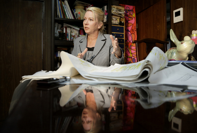 This photo taken Jan. 26, 2014 shows Catherine Fisher of Australia speaking during an interview at her home in Tokyo. An Associated Press investigation into the militarys handling of sexual assaul ...