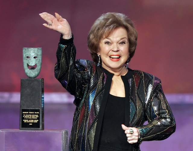 In this Jan. 29, 2006, file photo, Shirley Temple Black accepts the Screen Actors Guild Awards life achievement award at the 12th Annual Screen Actors Guild Awards, in Los Angeles. (AP Photo/Mark  ...