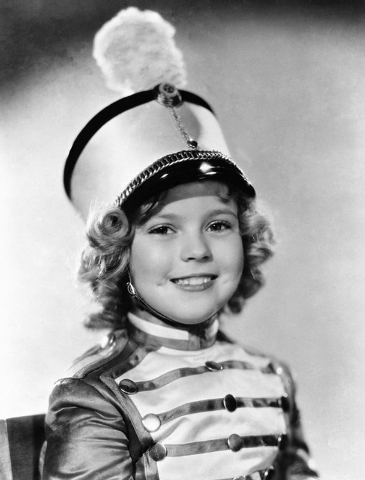 """Actress Shirley Temple is shown as she appeared in 1936 in """"Poor Little Rich Girl."""" Temple, who was born in 1928 and began acting at the age of 3, received an honorary Academy Award in 1934 for he ..."""