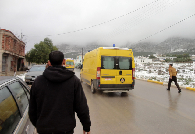 Ambulances drive near the site where an Algerian military transport aircraft slammed into a mountain in the countrys rugged eastern region, Tuesday, Feb. 11, 2014. A civil defense official said 10 ...