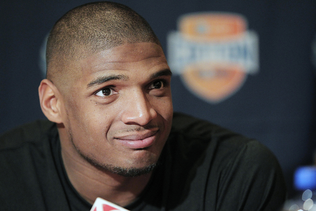 In this Jan. 1, 2014, file photo, Missouri senior defensive lineman Michael Sam speaks to the media during an NCAA college football news conference in Irving, Texas. Sam says he is gay, and he cou ...