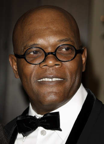 File-This Dec. 1, 2008 file photo shows actor Samuel L. Jackson arriving at the American Cinematheque Award gala honoring him in Beverly Hills, Calif.   Los Angeles newscaster has apologized to Ja ...
