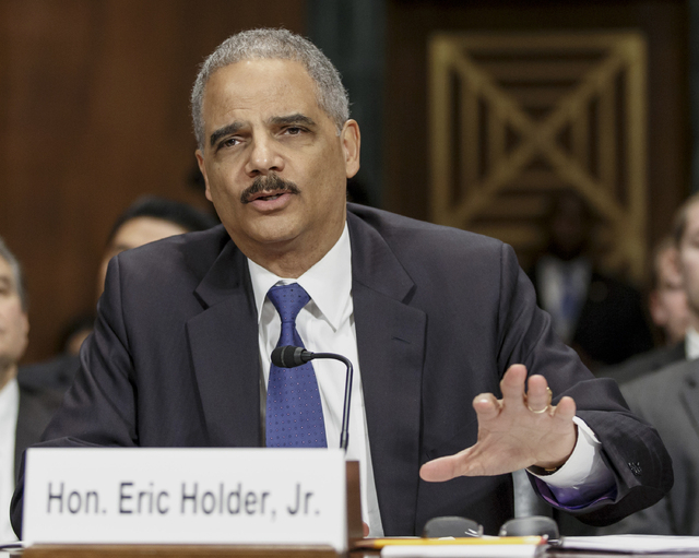 Attorney General Eric Holder said Monday that state attorneys general who believe that laws in their states banning same-sex marriage are discriminatory are not obligated to defend them. The appro ...