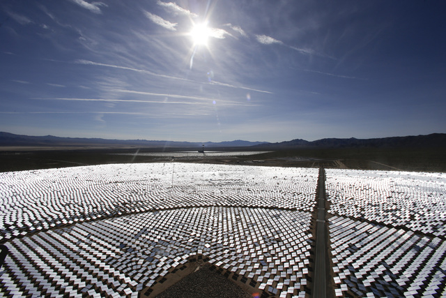 Some of the 300,000 computer-controlled mirrors, each about 7 feet high and 10 feet wide, reflect sunlight to boilers that sit on 459-foot towers. The sun's power is used to heat water in the boil ...