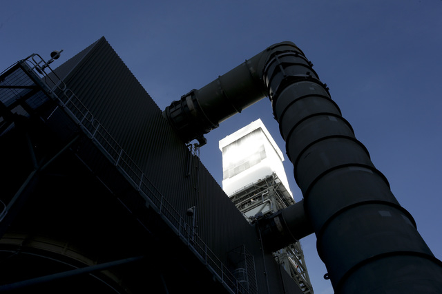 A boilers sits on 459-foot towers vents steam Tuesday, Feb. 11, 2014 in Primm, Nev. The Ivanpah Solar Electric Generating System, sprawling across roughly 5 square miles of federal land near the C ...