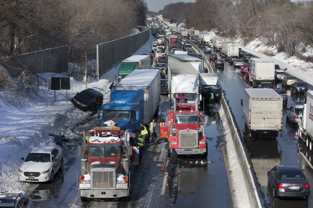 Vehicles are piled up in an accident Friday in Bensalem, Pa. Traffic accidents involving many vehicles have completely blocked one side of the Pennsylvania Turnpike outside Philadelphia and caused ...